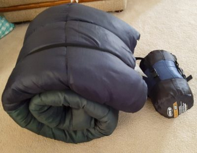 Our old sleeping bags compared to our new ultra-compact sleeping bags.