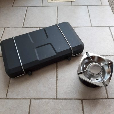 Our trusty Coleman two-burner camp stove and our new single-burner camp stove.